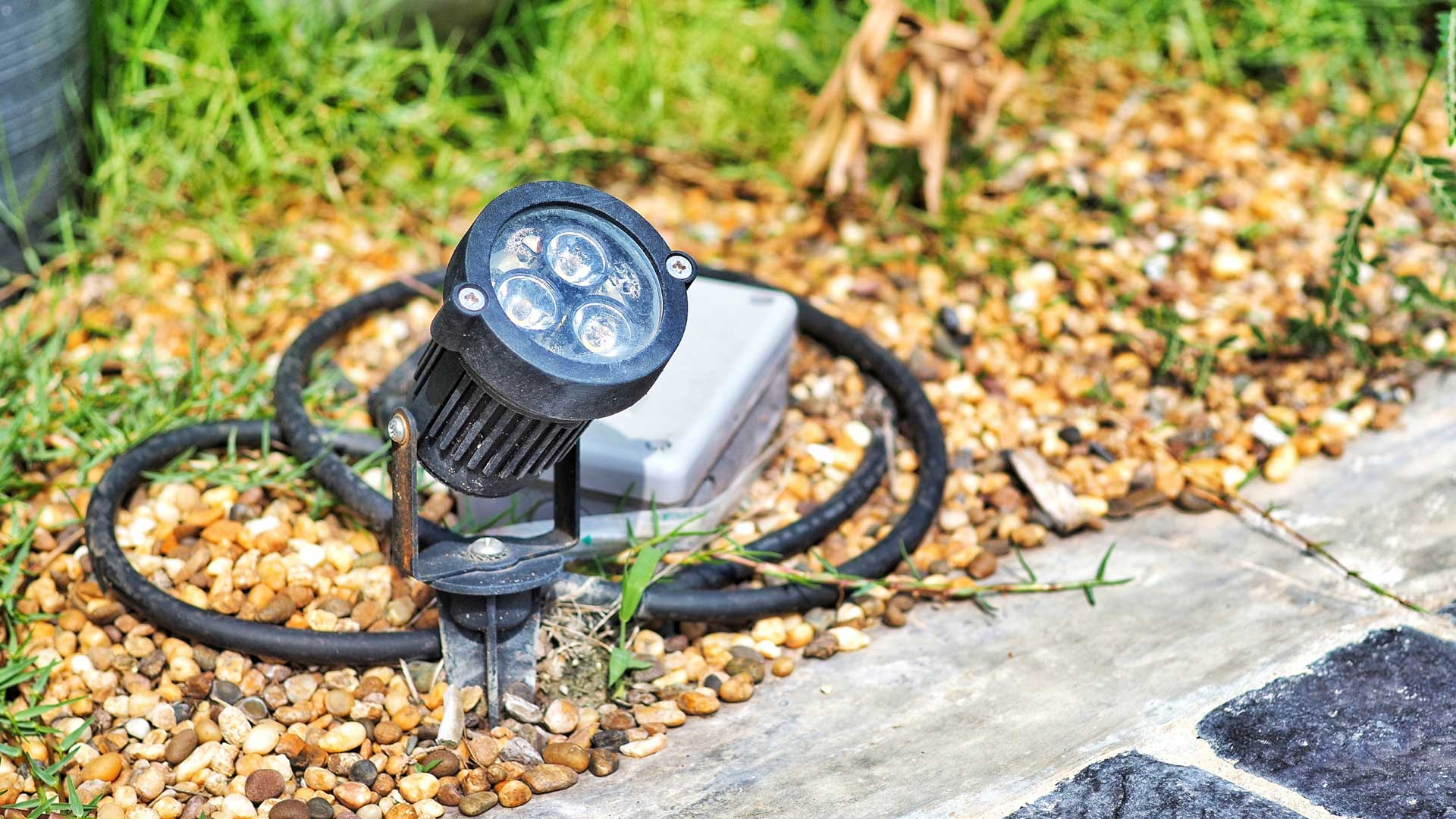 Landscape lighting fixture needing repaired at a property in Tellico Village, TN.