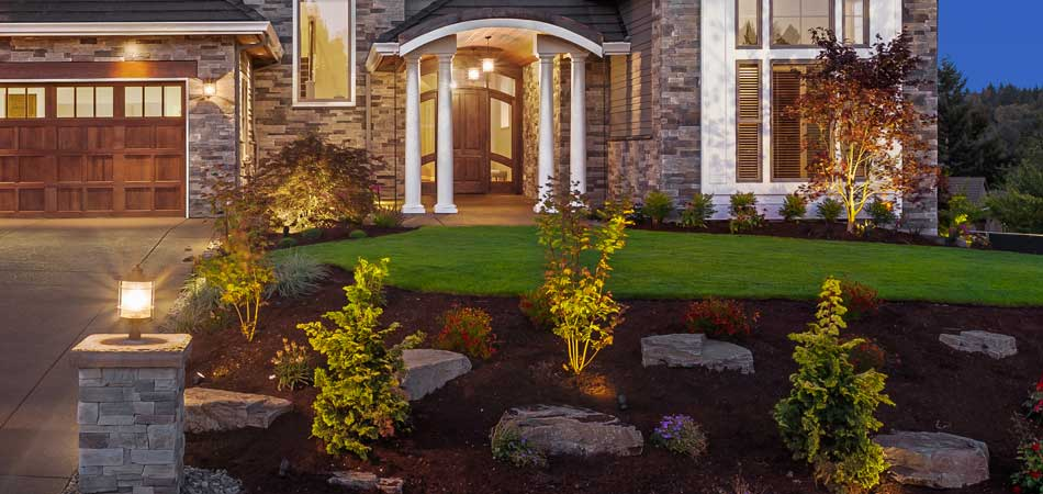 Properly maintained landscape lighting in front of a home in Farragut, TN.